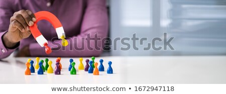 Businessperson Attracting Pawn Figures With Horseshoe Magnet Stock photo © AndreyPopov