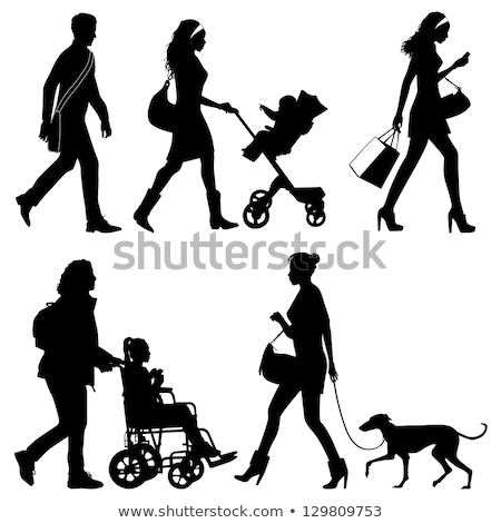 Silhouette Of A Woman Walking With A Person In Wheelchair Stock photo © AndreyPopov