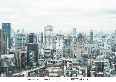 Osaka skyline grijs gebouwen blauwe hemel business Stockfoto © ShustrikS