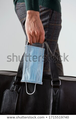 man carrying his luggage and a surgical mask Stock photo © nito