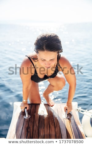 Zdjęcia stock: Young Woman Get On The Yacht On Sea At Sunny Day