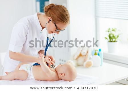 Médico pediatra bebê paciente clínica medicina Foto stock © dolgachov