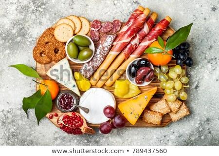 Cheese, meat and olives antipasto Stock photo © karandaev