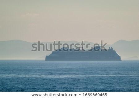 Cruzeiro navio mar silhueta Grécia pôr do sol Foto stock © dmitry_rukhlenko