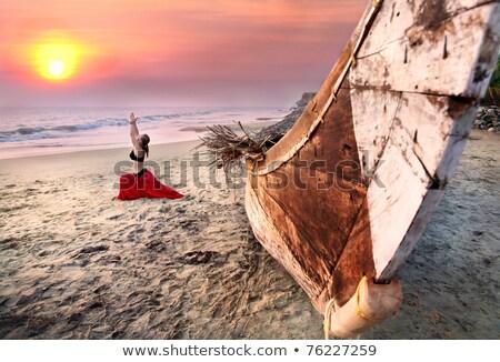 Mulher ioga guerreiro pose praia ao ar livre Foto stock © dmitry_rukhlenko