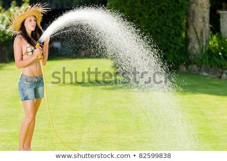 лет · саду · улыбающаяся · женщина · купальник · всплеск · воды - Сток-фото © CandyboxPhoto