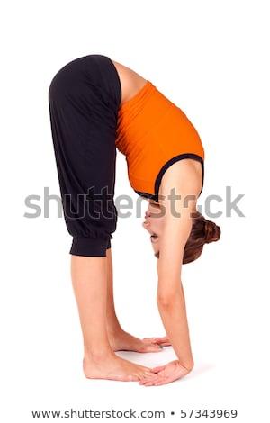 Woman Practicing Gorilla Pose Yoga Exercise Stock photo © rognar
