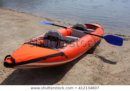 Beach colorful kayak rows lying on sand in sunny day Stock photo © lunamarina