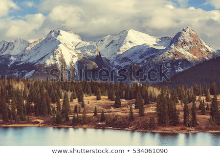 Paisagem montanhas montanha nebuloso manhã céu Foto stock © bbbar
