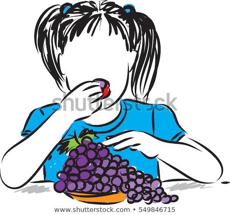 girl eating grapes stock photo © kalozzolak