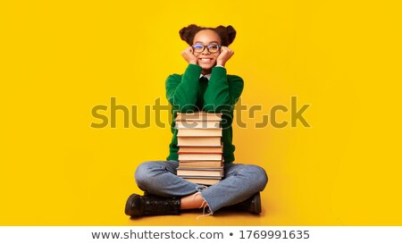 Stack of books isolated over black background Stock photo © Raduntsev