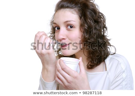 Young woman eating a pot of yoghurt Stock photo © photography33