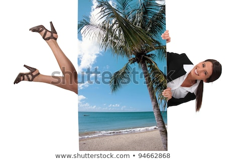Foto stock: Cute Female Travel Agent Flying Under Poster Of Beautiful Island