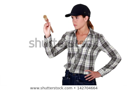 determined woman holding up a paintbrush stock photo © photography33