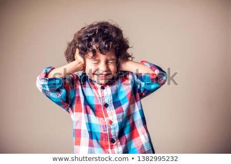 little boy closing his eyes and ears with his hands isolated on stock photo © dacasdo