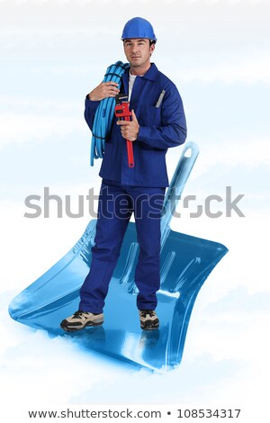 Plumber stood on giant shovel Stock photo © photography33