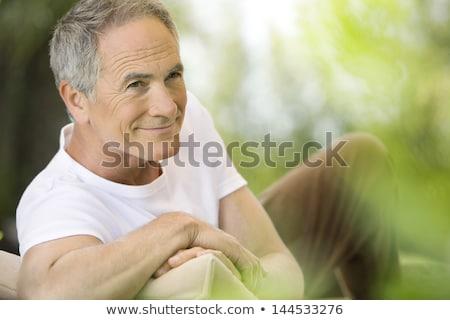 Középkorú férfi megnyugtató kert férfi nyár asztal Stock fotó © HASLOO