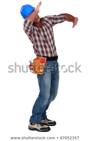 Tradesman using his arms to block a blow Stock photo © photography33