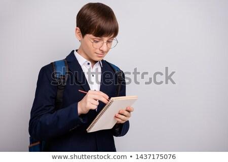 Serious secondary schoolboy in uniform Stock photo © lovleah