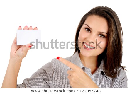 woman hand holding empty visiting card and pointing on it isolated on white stock photo © artjazz