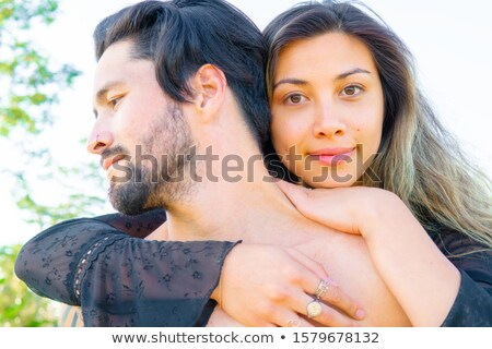 Happy Mixed Race Couple Flirting with Each Other stock photo © feverpitch