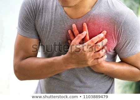 Mellkas fájdalom fiatal felnőtt férfi szenvedés orvosi Stock fotó © stevanovicigor