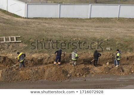 Construction worker riding a shovel Stock photo © photography33