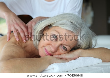 senior woman having a massage in a spa center stock photo © photography33