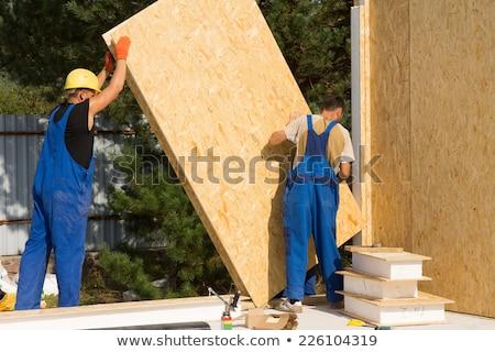 Charpentier bois maison construction maison pieds Photo stock © photography33