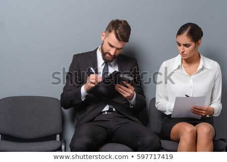stressed businesswoman in chair over white #2 Stock photo © dolgachov