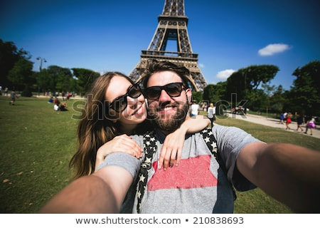 Stok fotoğraf: Travel Tourists Couple At Eiffel Tower Paris