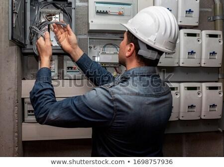Stok fotoğraf: Electrician Checking Voltage