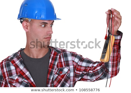 Wide-eyed tradesman staring at a multimeter Stock photo © photography33