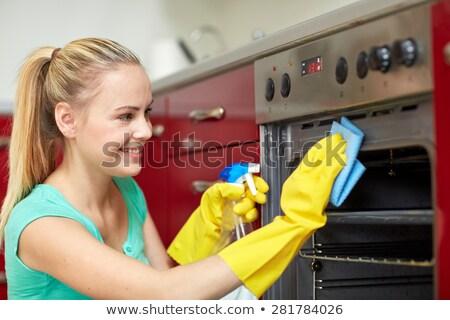 笑顔の女性 洗浄 オーブン キッチン ホーム 作業 ストックフォト © wavebreak_media