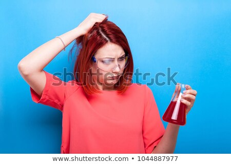 beautiful red haired female holding a test tube in a lab stock photo © wavebreak_media