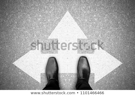 Stock photo: Black man shoes on the road.