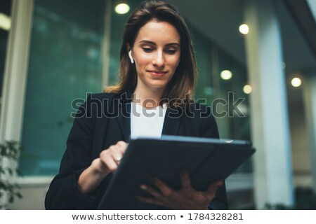 Businesswoman touching pane Stock photo © wavebreak_media