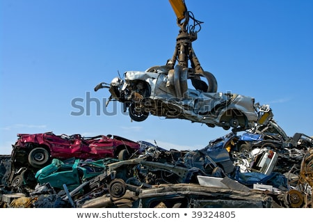 Crane picking up a car in a junkyard Stock photo © nemar974