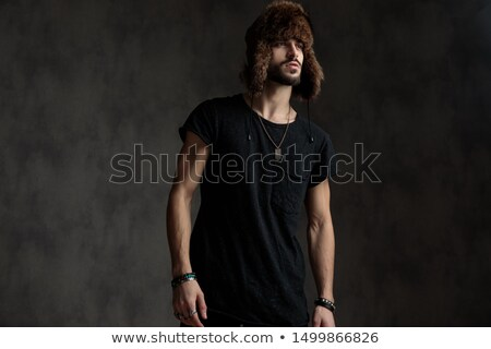 Young attractive man wearing fur Stock photo © konradbak
