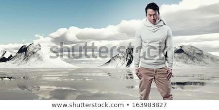 winter fur hat portrait of fashion young man Stock photo © lunamarina