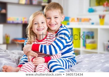 Hermano hermana junto sonriendo retrato hispanos Foto stock © iofoto