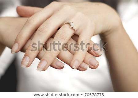 man inserting ring in womans finger stock photo © andreypopov