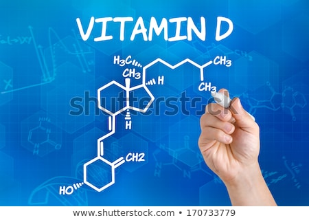 Hand with pen drawing the chemical formula of vitamin d stock photo © Zerbor