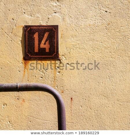 Number 14 On A Wall Сток-фото © Taigi