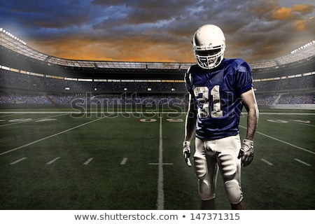 American football ball in the colored smoke Stock photo © cherezoff
