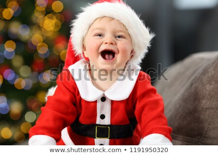 Stock fotó: Excited Young Boy In Front Of Christmas Tree