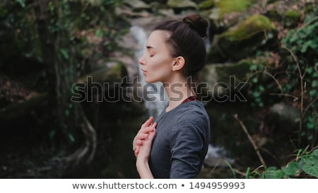 Woman practices yoga in nature, the waterfall. Stock photo © Geribody
