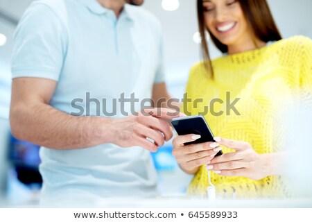 Marca nuovo telefono fuori vendita femminile Foto d'archivio © stockyimages