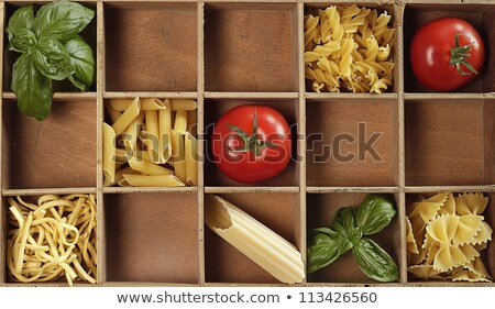 Dried pasta in a wooden box Stock photo © raphotos
