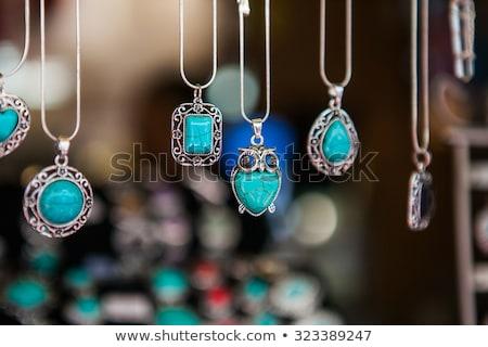 background of silver jewelry with blue precious stones Stock photo © yurkina